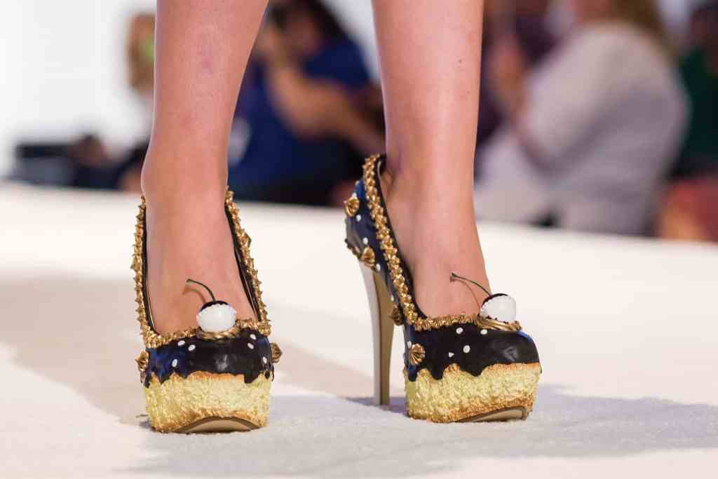 Sweet shoes made of sugary ingredients on the catwalk at the Sugar Art Fashion Show. photo credit: The Americas Cake Fair