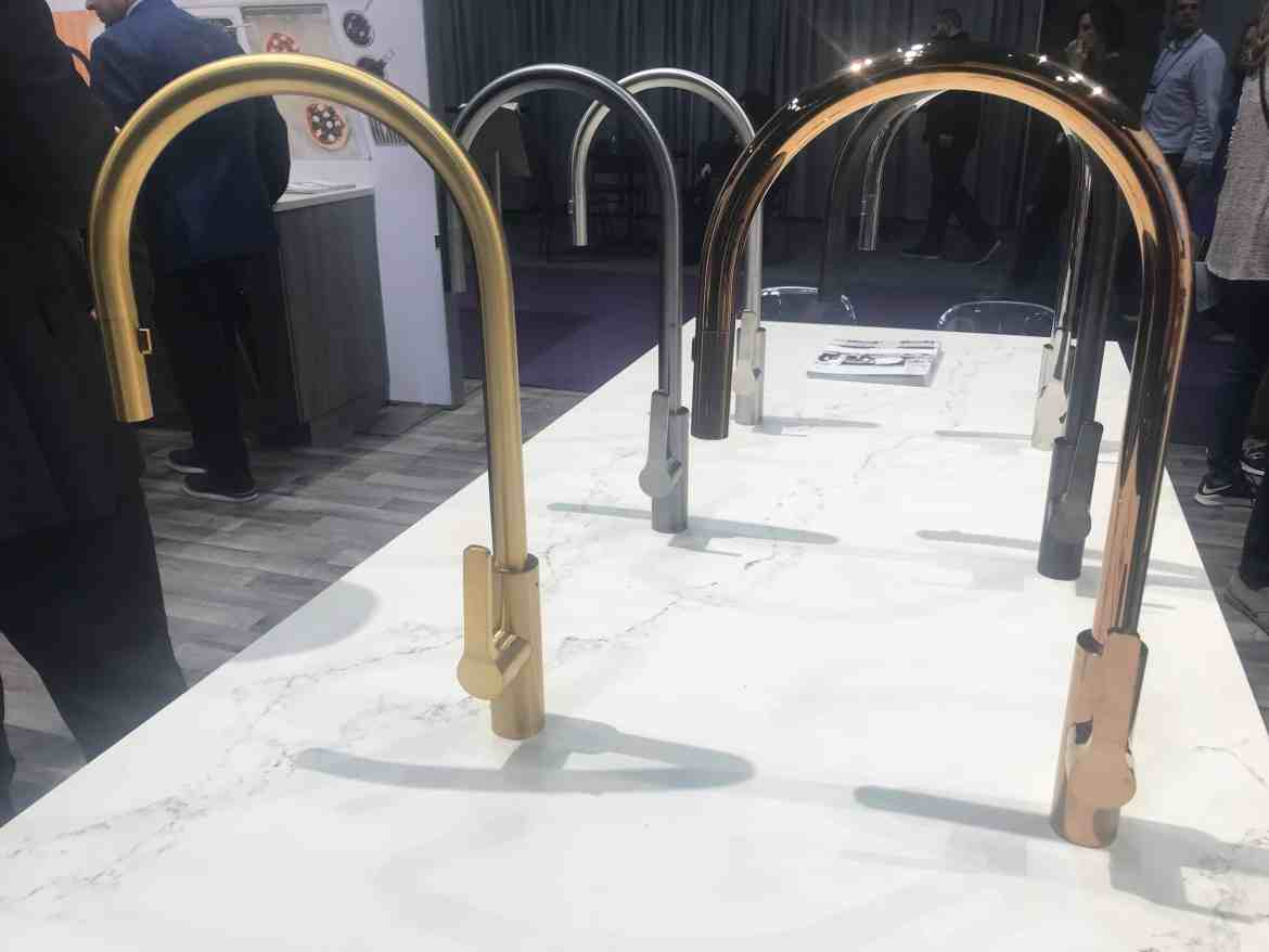 Rose Gold Faucet sits in the mix of brushed Gold, chrome and other finishes at the Kohler booth