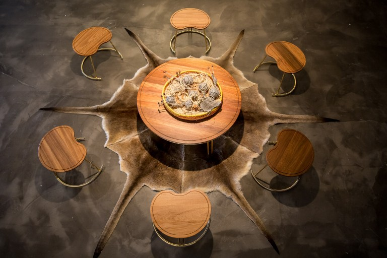 Nyinajimanha (sitting together) stool and table with kangaroo skin from above by Nicole Monks. Photo: Boaz Nothman