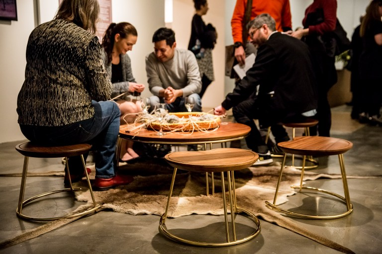 Having at yarn at the Nyinajimanha (sitting together) stool and table with kangaroo skin by Nicole Monks. Photo: Boaz Nothman