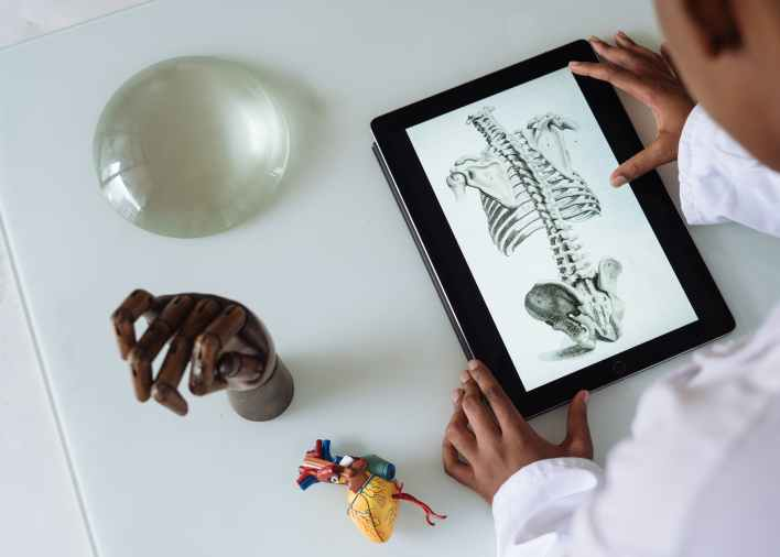 unrecognizable african american scientist studying anatomy with AR Healthcare