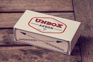 This is a mock-up of what you can expect to show up at your doorstep if you subscribe to Unbox Akron