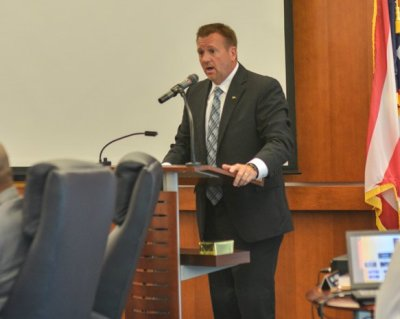 CFO Nathan Mortimer addressing the Board of Trustees at their August 12 meeting. (Photo: Shane Wynn)