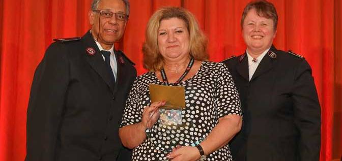 Devonport House Lifehouse acting service manager Jane Barwick (who accepted the award on Lyndsey Withers's behalf) is pictured with The Salvation Army's national leaders Commissioners Clive and Marianne Adams (both in uniform).