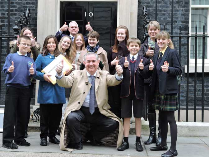 Geoffrey Cox with students at Number 10, Downing Street