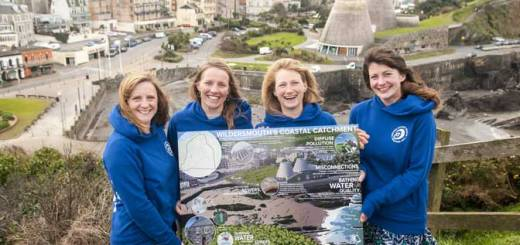 SAS Reps Jo Wakeham, Claire Moodie, Cal Major and Hollie Coleman withe the Cleaner Coastal Catchment sign above Wildersmouth beach and the Ilfracombe catchment. Courtesy of Rob Tibbles