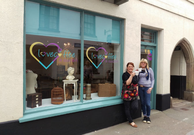 L-R Love Coffee Manager Tracey Kennedy with the Manager of Rowcroft's Churston Tea Room, Leigh Hanley, outside Rowcroft's new Love Coffee coffee shop in Ashburton