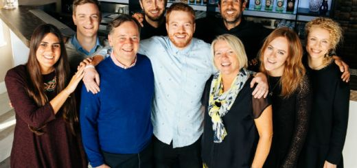 John McCarthy, Josh McCarthy and Barbara McCarthy (centre) with Chivas Brothers employees at the company's Hammersmith location