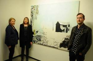"Marcus Lanyon, with White Moose owners Julie Gavin and Stella Levy, in front of his painting Petrichor at ""Age of Panic"" preview Show © John Andow"