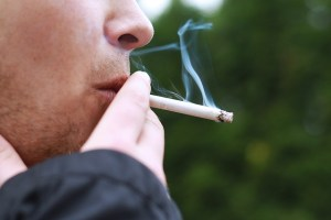 Photo of Man Smoking - Diabetes Doubles Risk of Death for Smokers