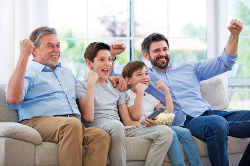 FAmily watching sports together