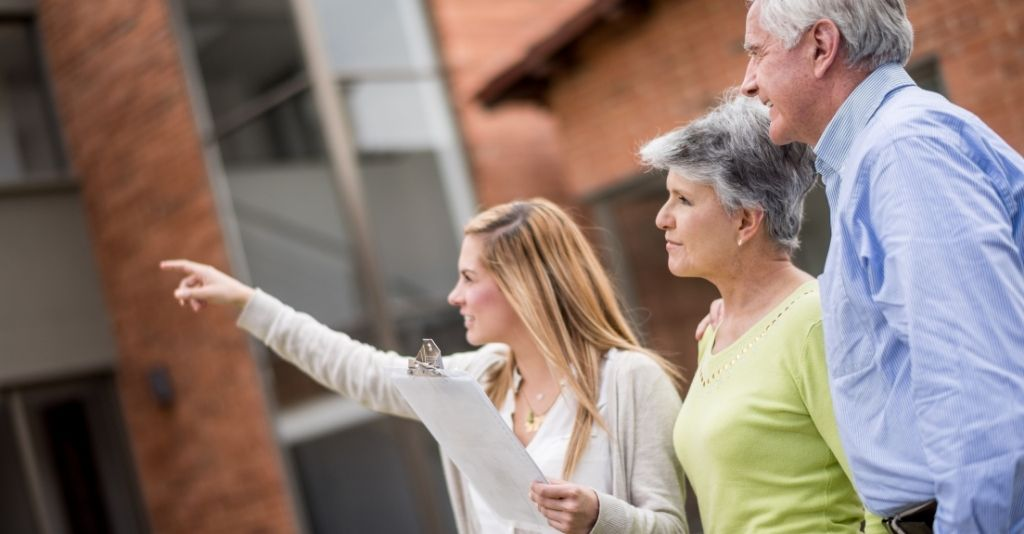 realtor showing a property to an older couple