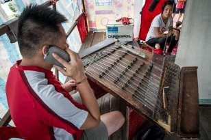 Brother Lih Shan plays the Chinese Yangqin (hammered dulcimer). Apparently he can do this in his sleep. He regularly answered his cell and chatted with folks.