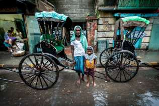 Father and Son. The Rickshaw pullers are mostly immigrant workers from other states. It is uncommon, but some manage to bring their families with them to Kolkata.