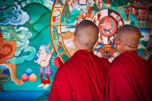 Two monks observing a tonka (a religious painting) of a Nubra Valley monastery.