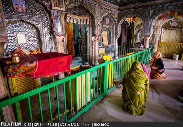 Praying to Krishna.