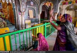 Worshiping Krishna.