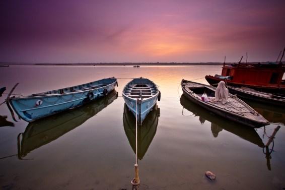 Meditating in his boat on the Ganges. Varanasi