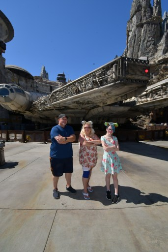 the disabled diva and family in front of the Millennium Falcon and Disneyland