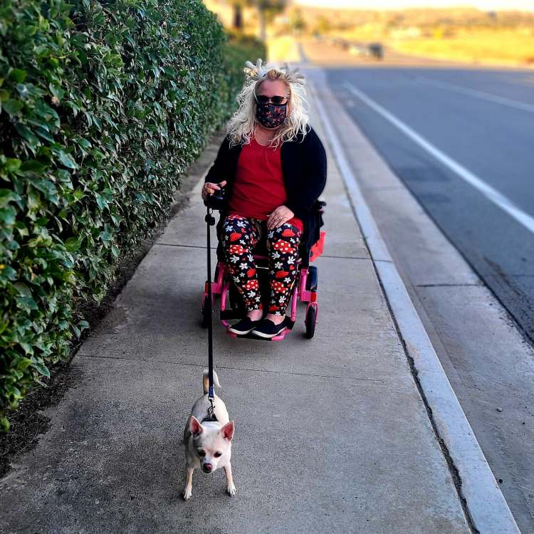 My pink power wheelchair allows me to go where I want, when I want to!