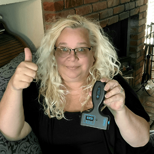 Blond woman giving Solis pain relief system a thumbs up for fibromyalgia muscle pain