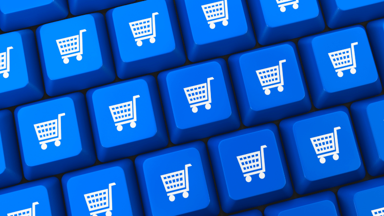 blue computer keyboard with shopping carts printed on keys instead of letters.