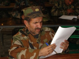An Afghan soldier in dire need of reading glasses