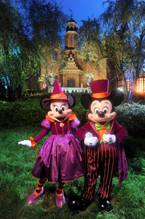 """Mickey and Minnie Mouse are decked out in their newest Halloween party-wear in front of the Haunted Mansion at the Magic Kingdom in Lake Buena Vista, Fla.  It's all part of the fun that takes place when the Magic Kingdom hosts """"Mickey's Not-So-Scary Halloween Party."""" A separate ticket is required to attend.  (Kent Phillips, photographer)"""
