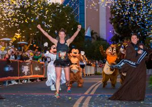 Jennifer Berry, 34, of Denver also seemingly runs at warp speed at Disney, streaking across the finish line Sunday as the female winner after doing the same thing last year at the Disneyland Half Marathon and the Disney Wine & Dine Half Marathon. This time she set a personal record (1:22:34) and easily beat out second-place finisher Carla McAlister of San Clemente, Ca. (1:25:32) and third-place finisher Kellie Nickerson of Albuquerque, NM (1:27:03).