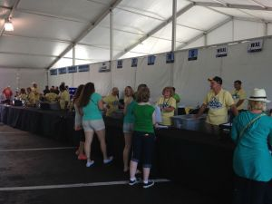 Packet pick-up with your t-shirt, bib and other items in a plastic bag.