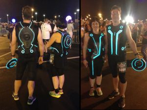 Two runners dressed as Tron Legacy characters. A beautiful work and the lights were still working after the race.