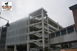 """The """"Orange"""" Parking Structure is finished, construction continues on the bridge over the road into down town"""