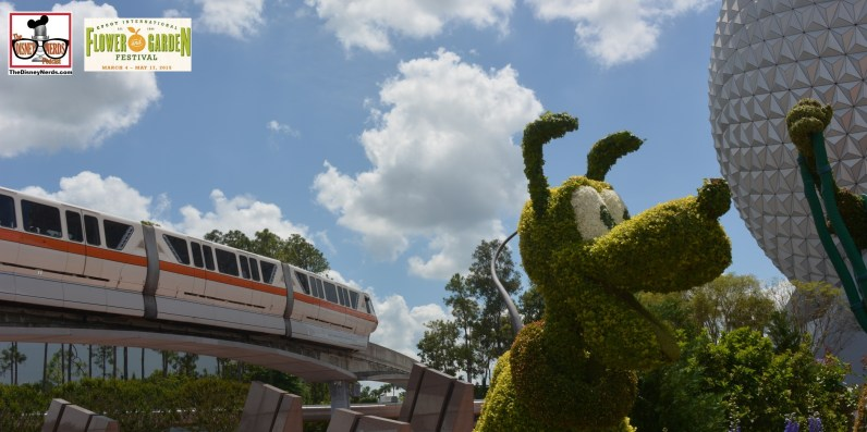 "Monorail passes the ""Goofy about Spring"" entrance Topiary - Flower and Garden Festival 2015"