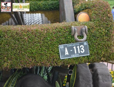 Love the detail. Maters license plate A-113 Mater in front of the Cactus Road Rally play area - Epcot International Flower and Garden Festival 2015