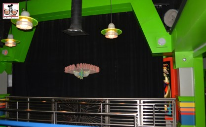 Over in tomorrow land, Buzz Light year Space ranger spin - Buzz is behind a curtain..