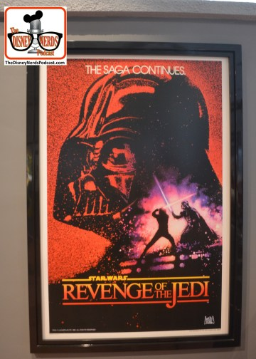 "2015-12 - Hollywood Studios -Star Wars Posters cover the queue - the posters cover everything in the star wars universe. - and the little known... ""Revenge of the Jedi""?"