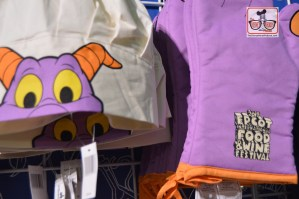 "More Merchandise inside the Festival Center - Figment Chiefs Hat and ""School House Rock"" logo gloves."