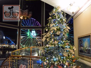 Christmas Tree inside Ariels Grotto with Mickey's Fun Wheel in the window