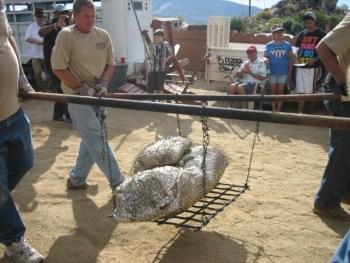 Roasting the pig on the Neal Cobb ranch, Reno
