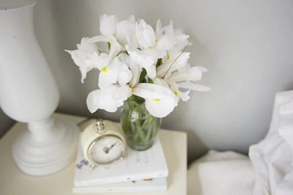 White flowers on nightstand