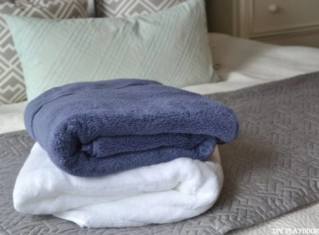 Blue-White-Towels-on-Bed