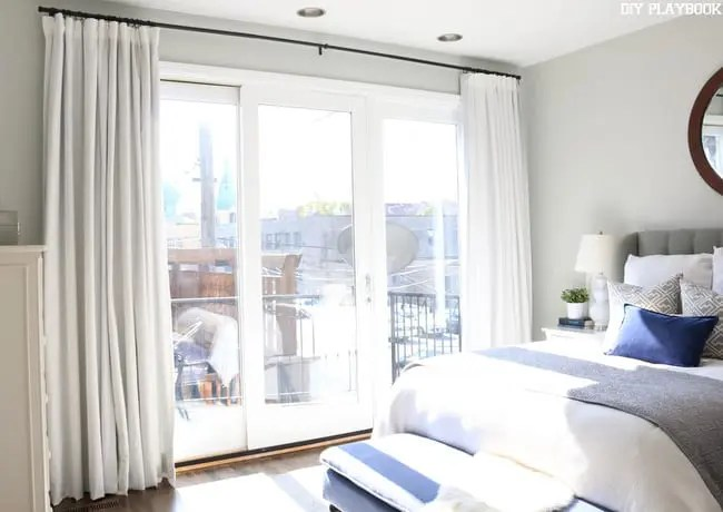 How to hang curtains high and wide to make your window ... on Master Bedroom Curtains  id=23689