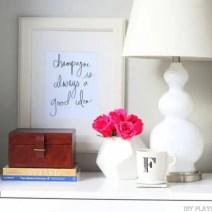 09-nightstand-styling-flowers-coffee-lamp