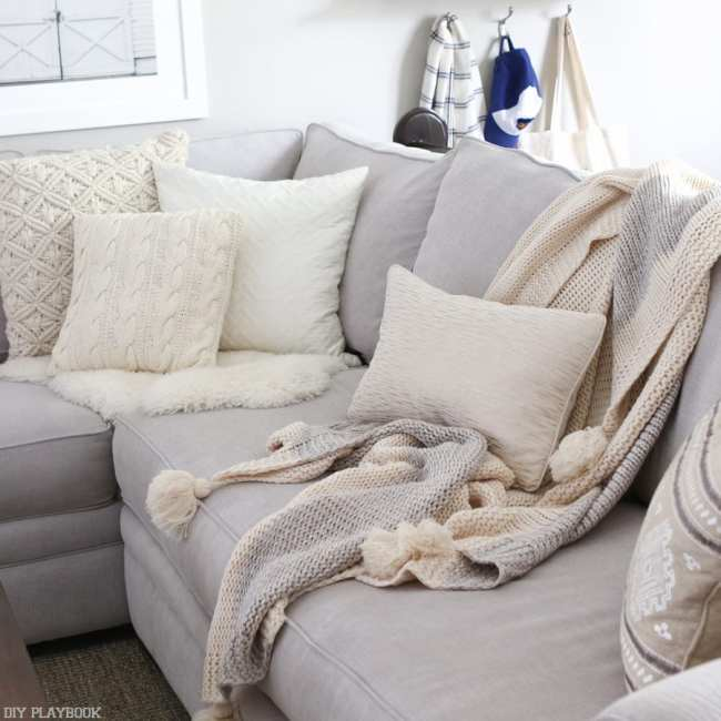 neutral-couch-pillows-blanket