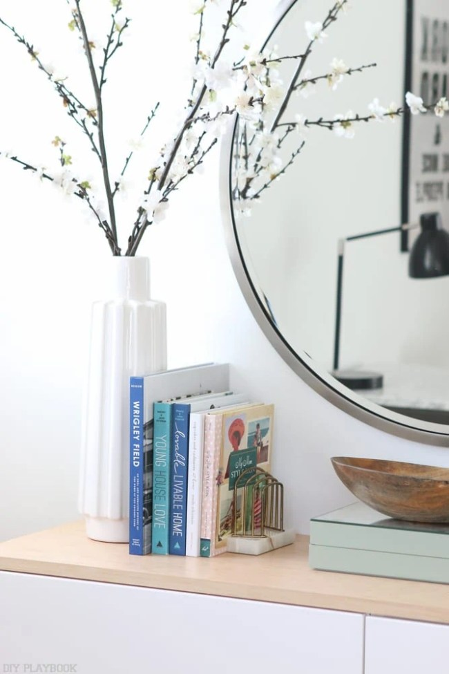 fauxdenza_mirror_Spring_branches_books_flowers-2