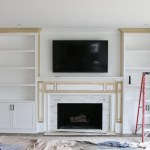 White Built Ins Around The Fireplace Before And After The