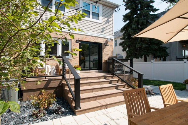 Our new deck in our backyard makeover reveal