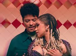 "Cardi B & Bruno Mars Share Visuals For ""Please Me"""