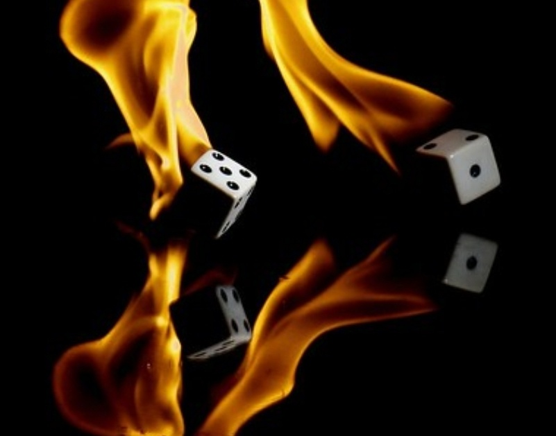 two dice on fire