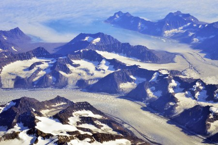 Aerial view of some of Greenland's mountains. Approximately 80% of the island's area is totally ice capped.
